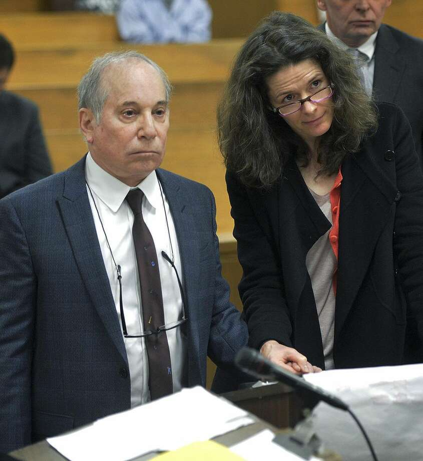 Singer Paul Simon, left, holds hands with his wife Edie Brickell at a hearing in Norwalk Superior Court on Monday April 28, 2014 in Norwalk, Conn. The couple were arrested Saturday on disorderly conduct charges by officers investigating a family dispute at their home in New Canaan, Conn. (AP Photo/The Hour, Alex von Kleydorff, Pool)