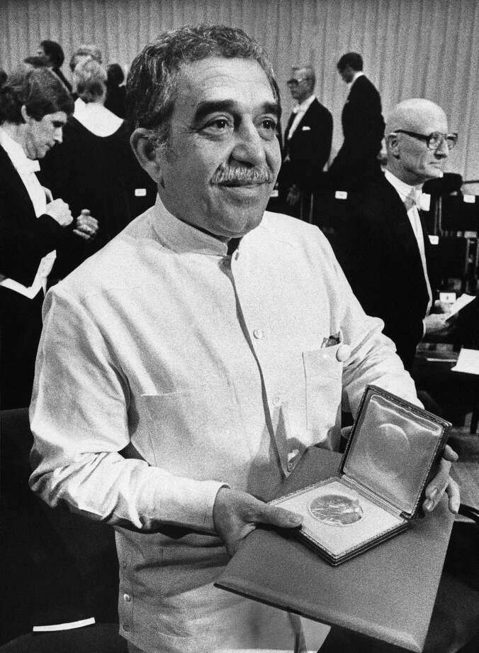 In this Dec. 8, 1982 file photo, Nobel laureate Gabriel Garcia Marquez shows his Nobel Prize medal after he delivered his Nobel Lecture in Stockholm, Sweden. Marquez died Thursday April 17, 2014 at his home in Mexico City. (AP Photo/Bjorn Elgstrand, Pool, File)