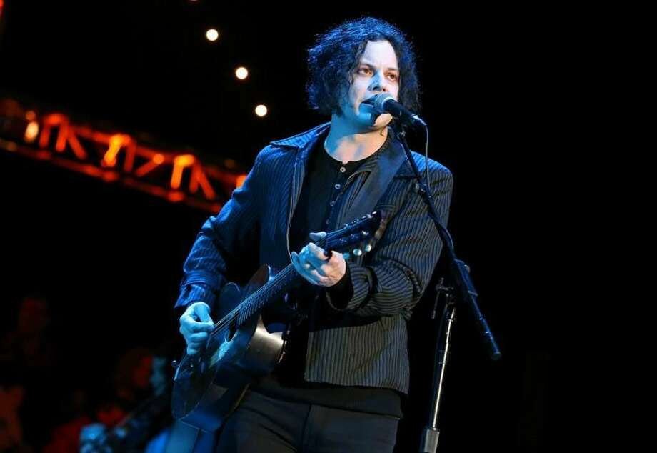 """This Oct. 20, 2012 photo shows Jack White performing at the Bridge School Benefit Concert in Mountain View, Calif. White is going direct to vinyl with the first live performance of a song off his upcoming album on Record Store Day. Fans got to see him perform the title track from """"Lazaretto"""" on Saturday morning, which was recorded and pressed into a limited edition vinyl record that afternoon. (Photo by Barry Brecheisen/Invision/AP, File)"""