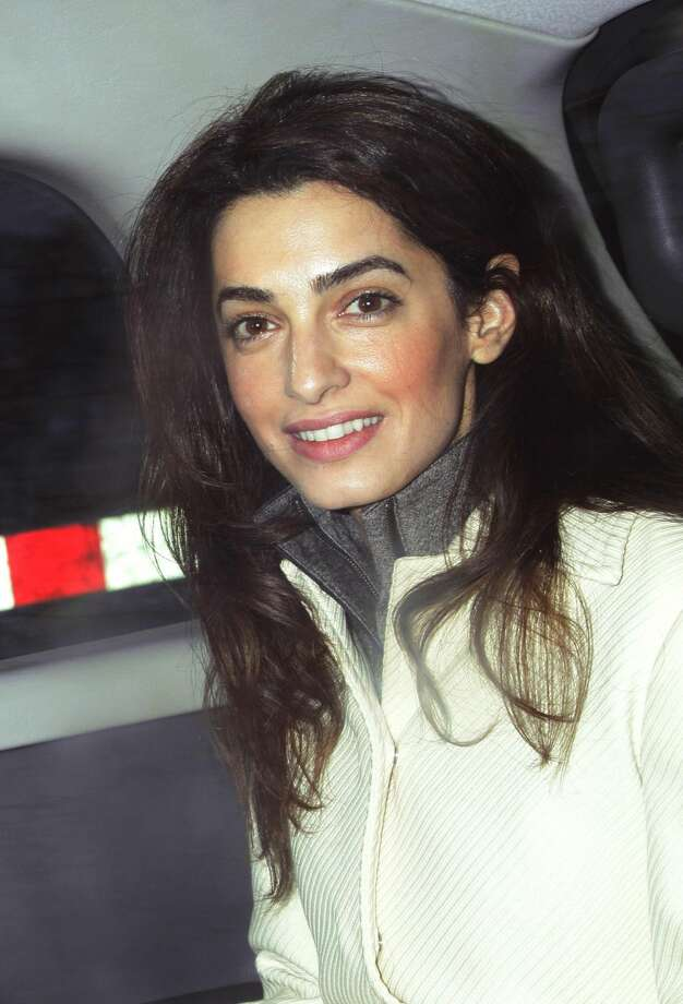 FILE - This Feb. 7, 2011 file photo shows human rights attorney Amal Alamuddin, in London. Hollywood�s most determined bachelor, George Clooney, recently proposed to the 36-year-old Alamuddin, despite repeated protestations that marriage wasn�t for him. A spokesman for the Oscar-winning actor and producer did not respond to requests for comment Monday, April 28, 2014. (AP Photo/PA, Yui Mok, File)