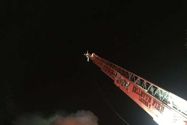 Bellevue firefighters were searching a burning condominium building for survivors Monday night.