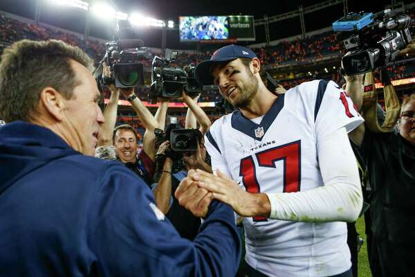 Denver Broncos head coach Gary Kubiak shakes hands with his former player, Houston Texans quarterback Brock Osweiler (17), after an NFL football game at Sports Authority Field at Mile High on Monday, Oct. 24, 2016, in Denver.