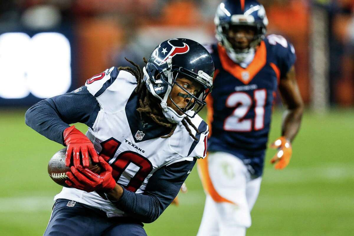 Houston Texans wide receiver DeAndre Hopkins (10) makes a catch during the fourth quarter of an NFL football game at Sports Authority Field at Mile High on Monday, Oct. 24, 2016, in Denver.