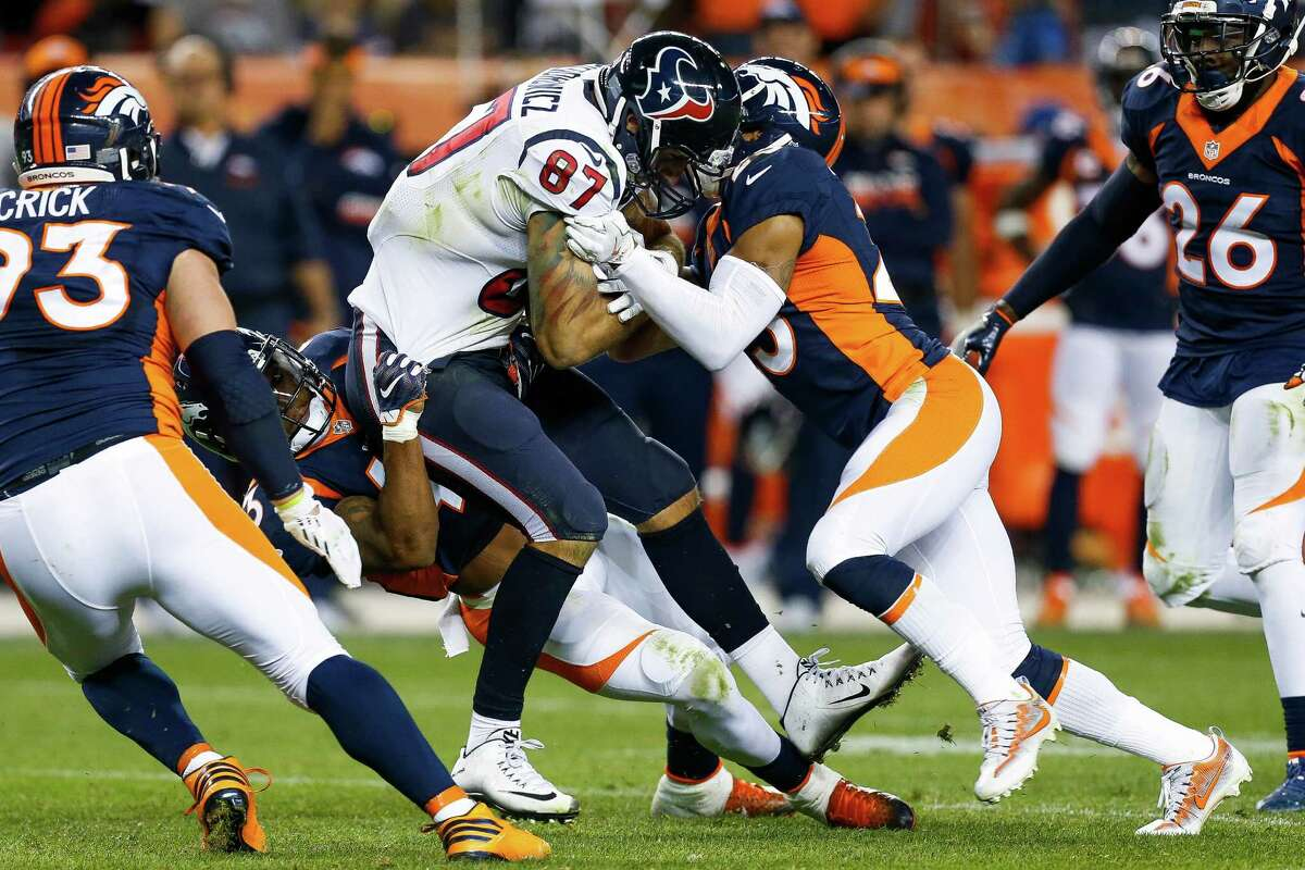 Houston Texans tight end C.J. Fiedorowicz (87) gets tackled during the fourth quarter of an NFL football game at Sports Authority Field at Mile High on Monday, Oct. 24, 2016, in Denver.