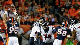 The Texans' passing attack vanished in the thin air of Denver as Brock Osweiler was 22-of-41 for 131 yards. This attempt slipped from his hand and was ruled a fumble.