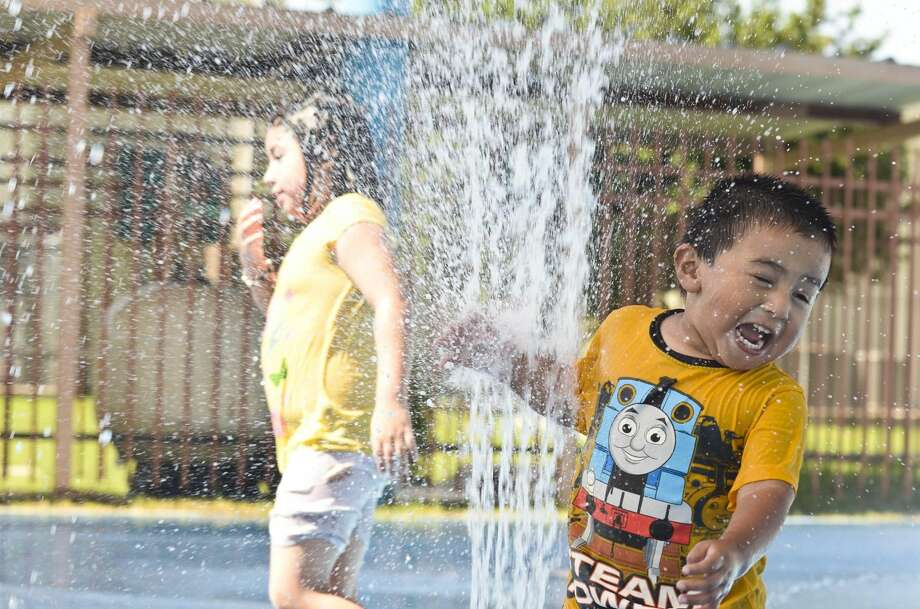 Antonio Gabriel laughs as he approaches the stream of water shooting from the ground at the Farias Water Park in this June 18, 2013 file photo. Click through the gallery to see the top 21 water parks in Texas.