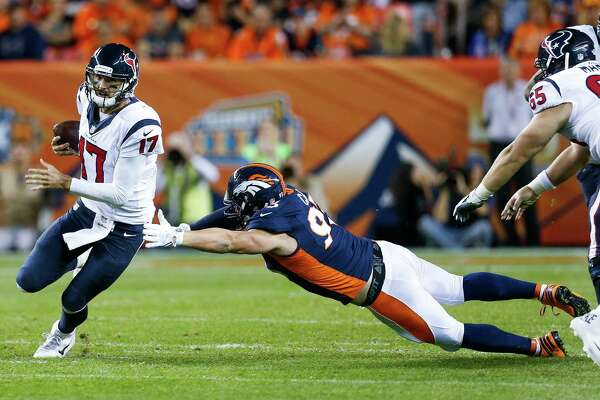 Houston Texans quarterback Brock Osweiler (17) avoids a tackle by Denver Broncos defensive end Jared Crick (93) during the second quarter of an NFL football game at Sports Authority Field at Mile High on Monday, Oct. 24, 2016, in Denver. ( Brett Coomer / Houston Chronicle )
