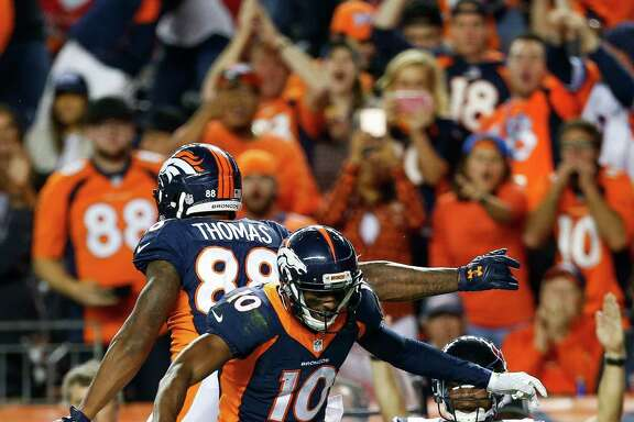 Broncos wide receiver Demaryius Thomas (88) celebrates his touchdown reception with receiver Emmanuel Sanders in Denver's 27-9 victory over the Texans at Sports Authority Field at Mile High.