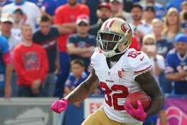 San Francisco 49ers kick returner Torrey Smith (82) carries the ball during the first half of an NFL football game against the Buffalo Bills on Sunday, Oct. 16, 2016, in Orchard Park, N.Y. (AP Photo/Bill Wippert)