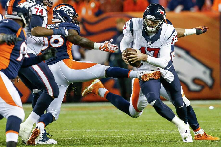 Houston Texans quarterback Brock Osweiler (17) takes a foot to the crotch from Denver Broncos outside linebacker Von Miller (58) during the second quarter of an NFL football game at Sports Authority Field at Mile High on Monday, Oct. 24, 2016, in Denver. Photo: Brett Coomer, Houston Chronicle / © 2016 Houston Chronicle