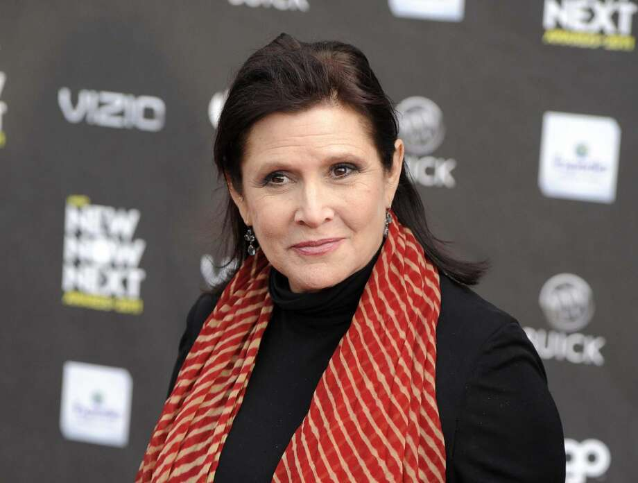 "FILE - This April 7, 2011 file photo shows Carrie Fisher at the 2011 NewNowNext Awards in Los Angeles. Fisher is excited about her ""Star Wars"" return, even if she can't say much about it. Production begins in May 2014 on Disney's ""Star Wars"" film by director J.J. Abrams. (AP Photo/Chris Pizzello, file)"