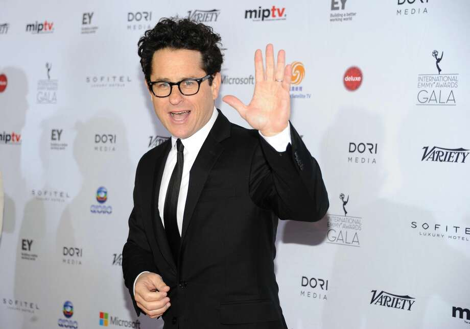 """In this Nov. 25, 2013 file photo, r=the """"Founders Award"""" recipient producer and director J.J. Abrams arrives at the 2013 International Emmy Awards Gala at the New York Hilton, in New York. From the set of """"Star Wars: Episode VII"""" in Abu Dhabi, the director Abrams announced the launch of Star Wars: Force for Change, a campaign to raise funds for United Nations Children's Funds (UNICEF). The campaign will run from 12:01 a.m. PDT on May 21, 2014, until 11:59 p.m. PDT on July 18. (Photo by Evan Agostini/InvisionAP, file)"""