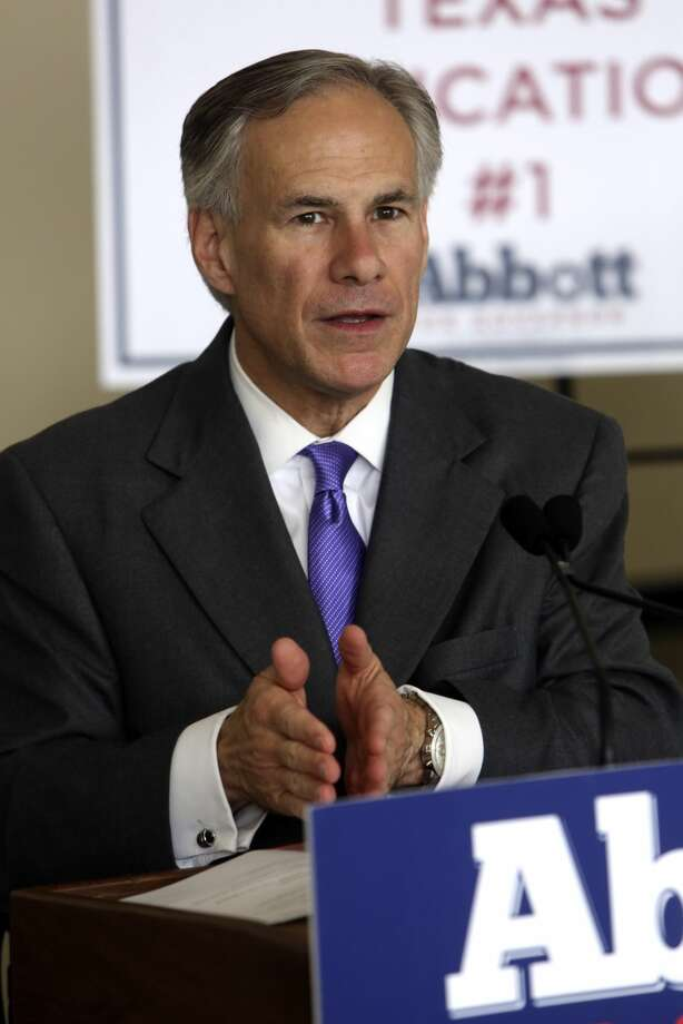 GOP gubernatorial nominee Greg Abbott discusses his education policies while visiting the Toyota plant in San Antonio on Monday. The Webb County Democratic Party will protest Abbott's education plans on Thursday. (Helen L. Montoya/San Antonio Express-News)