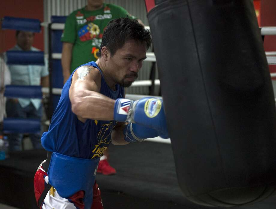 In this photo taken on September 29, 2016, Philippine boxing icon Manny Pacquiao trains at a gym in Manila, ahead of his November 6 bout with Mexican boxer Jessie Vargas.  Pacquiao insisted September 30 he owed his fans and countrymen no apology after admitting to having used illegal drugs. / AFP PHOTO / TED ALJIBETED ALJIBE/AFP/Getty Images Photo: TED ALJIBE, AFP/Getty Images