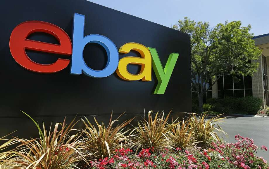 FILE - This Tuesday, July 16, 2013, file photo shows an eBay sign at eBay headquarters in San Jose, Calif. EBay is urging shareholders on Monday, March 10, 2014, to vote for its directors rather than the pair put up by activist investor Carl Icahn. (AP Photo/Ben Margot, File)