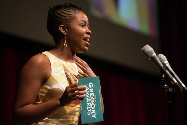 Claudine Mboligikpelani Nako receives an award for Outstanding Actress: Musical during the 8th annual Gregory Awards at McCaw Hall on Monday, Oct. 24, 2016.