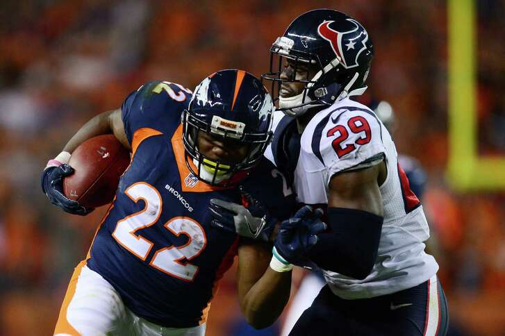 DENVER, CO - OCTOBER 24:  Running back C.J. Anderson #22 of the Denver Broncos rushes for 19 yards and is tackled by free safety Andre Hal #29 of the Houston Texans in the third quarter of the game at Sports Authority Field at Mile High on October 24, 2016 in Denver, Colorado.