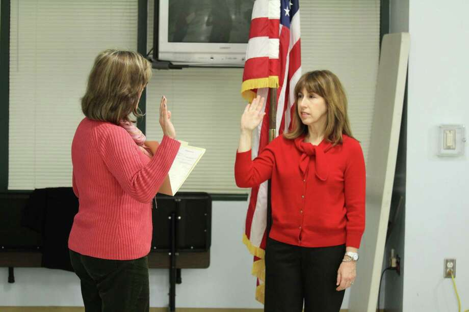 Town Clerk Patricia Strauss swears in new Board of Education Member Candice Savin on Oct. 24, 2016 at Staples High School in Westport, CT. Photo: Chris Marquette / Hearst Connecticut Media / Westport News