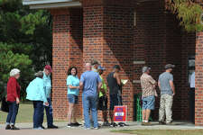 Voters line up at Rogers Park Monday to cast a ballot on the first day of early voting.  Photo taken Monday, October 24, 2016 Guiseppe Barranco/The Enterprise