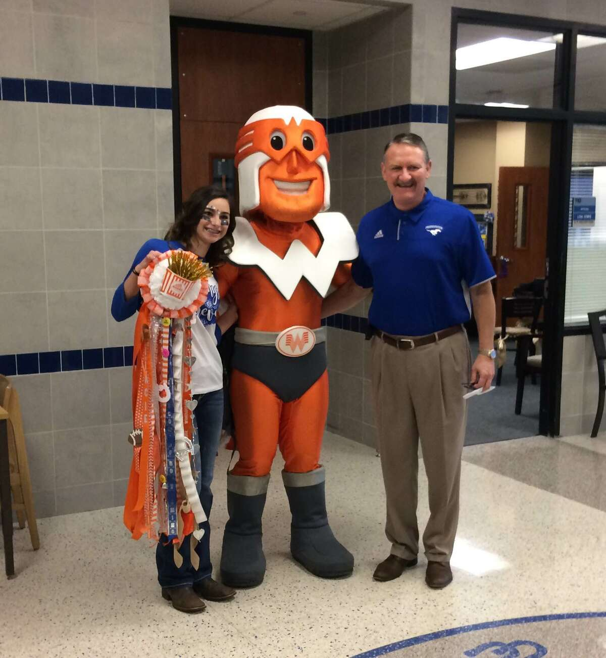 Gracie Kempken with Whataguy and Friendswood High School Principal Mark Griffon. Keep clicking for more Texas students' tweets that prove homecoming and Whataburger go together like honey butter and biscuits.