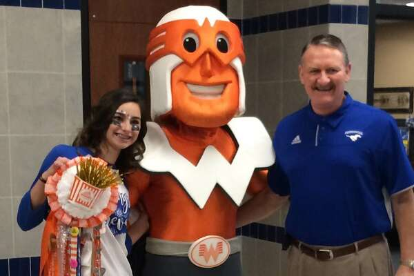 Gracie Kempken with Whataguy and Friendswood High School Principal Mark Griffon.
