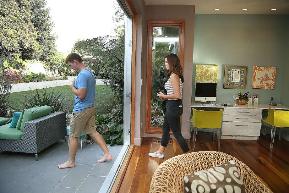 Jody Brettkelly's children head to the backyard from the living space of the home. Photo: Liz Hafalia, The Chronicle