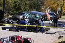 LITCHFIELD, CT - 23 October 2016 - 102316JM02 - Litchfield, Conn. Volunteer Ambulance emergency medical technician Mike Castelli and a Connecticut state trooper work at the scene of an accident involving a car and several motorcycles on Route 63 in Litchfield, Conn on Sunday October 23rd 2016. (AP Photo/The Republican-American, John McKenna)