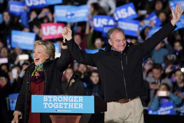 US Democratic presidential candidate Hillary Clinton and running mate  Tim Kaine arrive for a rally in Philadelphia, Pennsylvania on October 22, 2016. / AFP PHOTO / DOMINICK REUTERDOMINICK REUTER/AFP/Getty Images