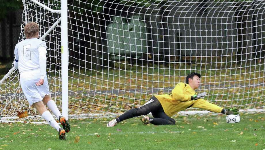 Greens Farms Academy senior Michael Medvedev puts one past the goalie in the team's game against EF Academy on Saturday, Oct. 22. Earlier in the week, Medvedev had five assists in a victory over St. Luke's. Photo: Contributed / Photo