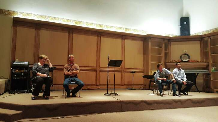 Roman Forest City Council candidates sit onstage during a candidate forum held at Impact Church in Roman Forest Oct. 20. Barbara Greene, left, Blake Sudberry, David Mullane  and Tony Garza take questions from the community.