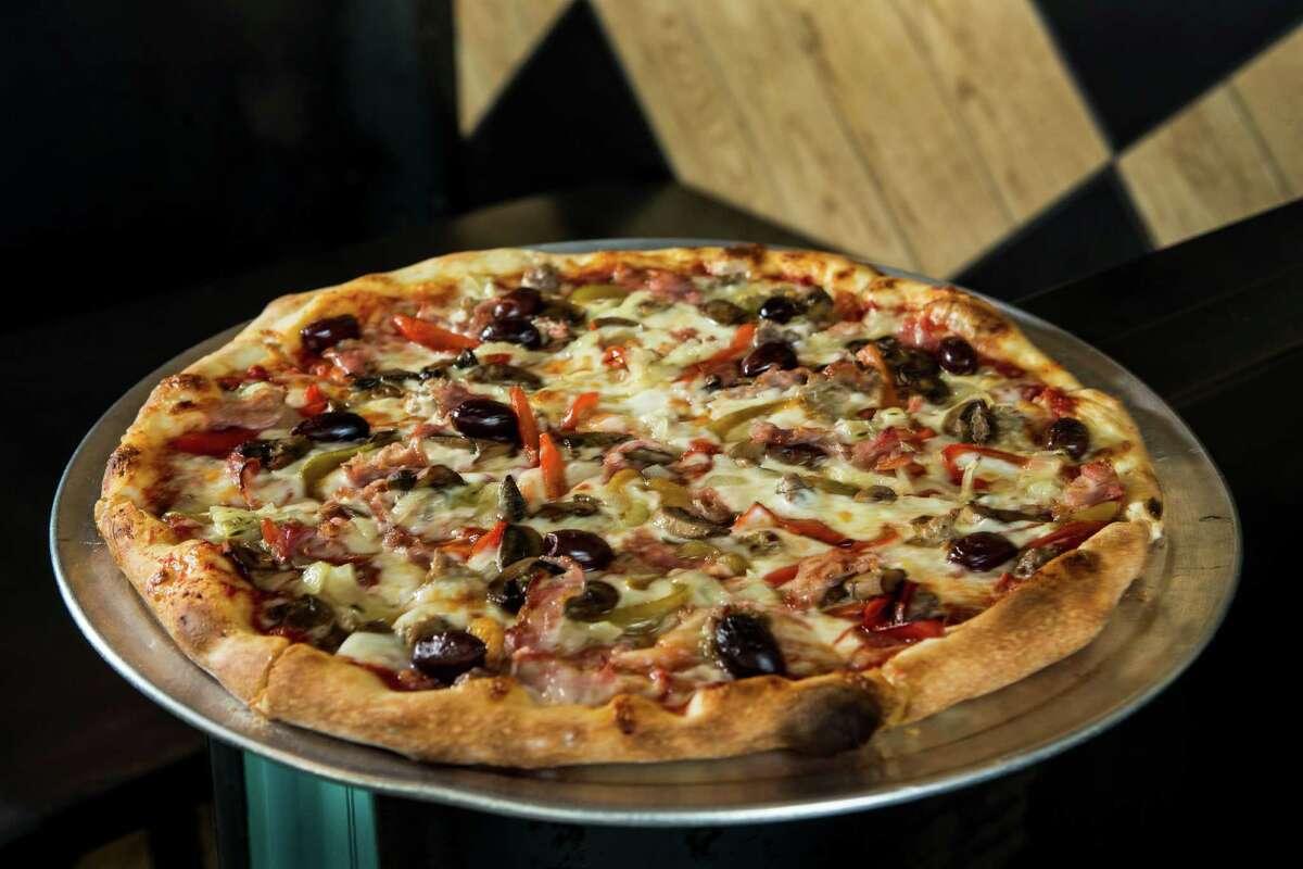 The Supreme pizza is shown at Pi Pizza on Thursday, Oct. 20, 2016, in Houston. ( Brett Coomer / Houston Chronicle )