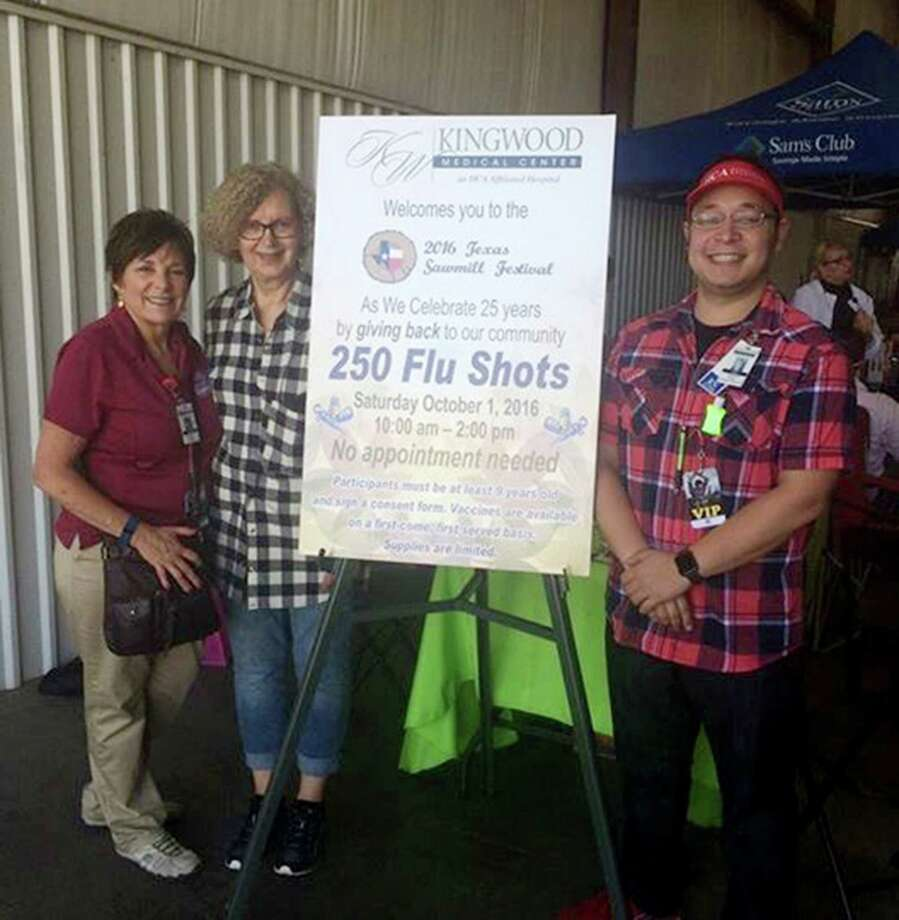Kingwood Medical Center Director of Community and Public Relations, Devon Alexander, Pat Balcom and Carl Balcom, Kingwood Medical Center Director of Emergency Services donating flu shots at The Texas Sawmill Festival Photo: Courtesy