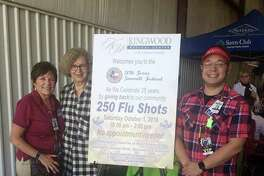 Kingwood Medical Center Director of Community and Public Relations, Devon Alexander, Pat Balcom and Carl Balcom, Kingwood Medical Center Director of Emergency Services donating flu shots at The Texas Sawmill Festival