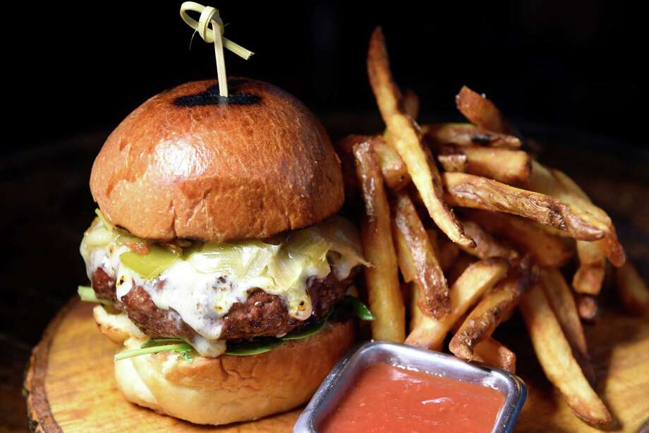 The People's Burger features Kinderhook Farms beef and ODB brioche with hand-cut and triple-cooked fries on Thursday, Oct. 20, 2016, at The People's Pub in Chatham, N.Y. (Cindy Schultz / Times Union) Photo: Cindy Schultz / Albany Times Union