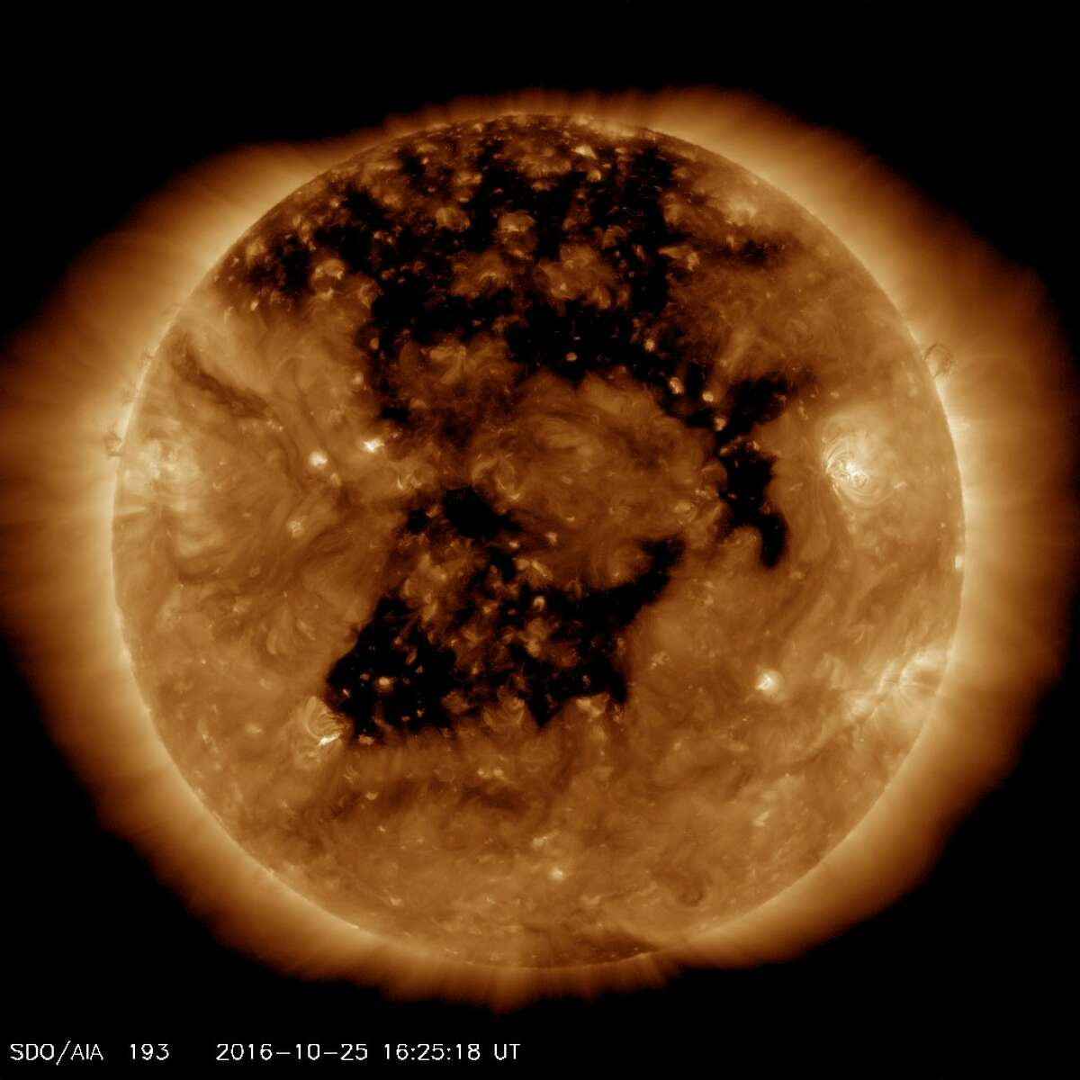 The sun as seen on Tuesday morning. The big black areas are coronal holes through which hot gasses escape the sun's surface and stream into space, sometimes hitting the Earth and causing stronger auroras and some electronic disturbances.