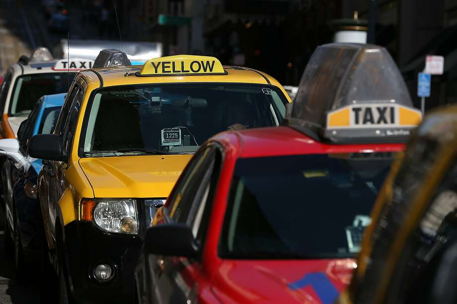 SAN FRANCISCO, CA - JANUARY 21: Taxicabs wait for fares in front of the St. Francis Hotel on January 21, 2014 in San Francisco, California. As ridesharing services like Lyft, Uber and Sidecar become more popular, the San Francisco Cab Driver Association is reporting that nearly one third of San Francisco's licensed taxi drivers have stopped driving taxis and have started to drive for the ridesharing services.  Photo: Justin Sullivan, Getty Images