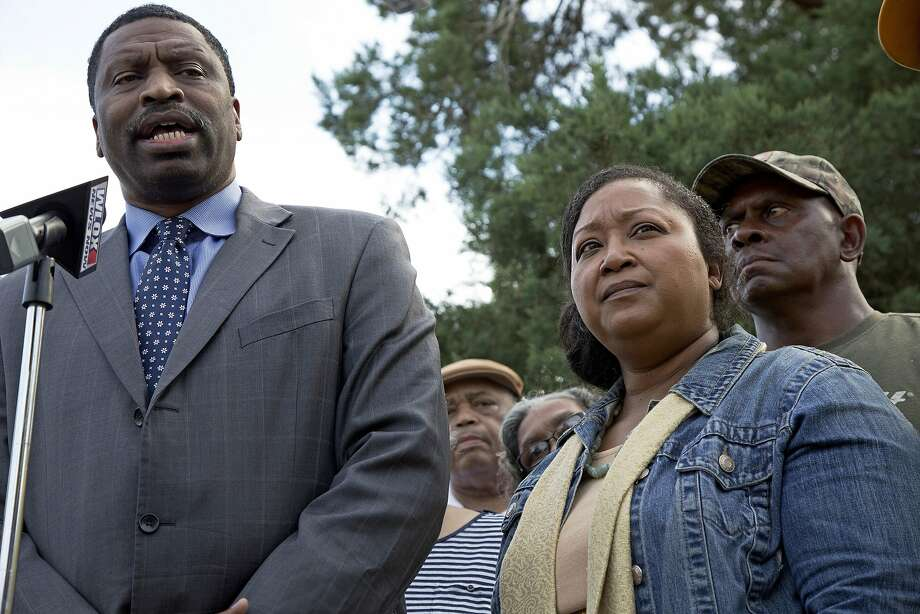 CORRECTS STATE TO MISSISSIPPI - Derrick Johnson, left, president of the Mississippi NAACP, talks to the media on behalf of Stacey Payton, center right, and Hollis Payton, right, the parents of a high school student, in front of the Stone County Courthouse in Wiggins, Miss., Monday, Oct. 24, 2016. Johnson is demanding a federal investigation after the parents said four white students put a noose around their son's neck at school. (AP Photo/Max Becherer) Photo: Max Becherer, Associated Press