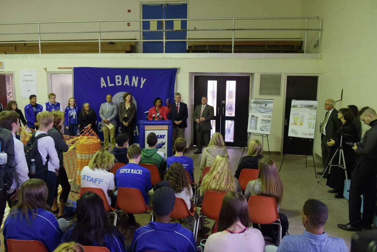 Kimberly Young Wilkins, at podium, interim Albany School District superintendent, addresses those gathered at a groundbreaking ceremony for Albany High SchoolOs pool building on Tuesday, Oct. 25, 2016, in Albany, N.Y. The pool has been out of service since March 2015, and so the swim team has been practicing and competing in other area pools. (Paul Buckowski / Times Union)