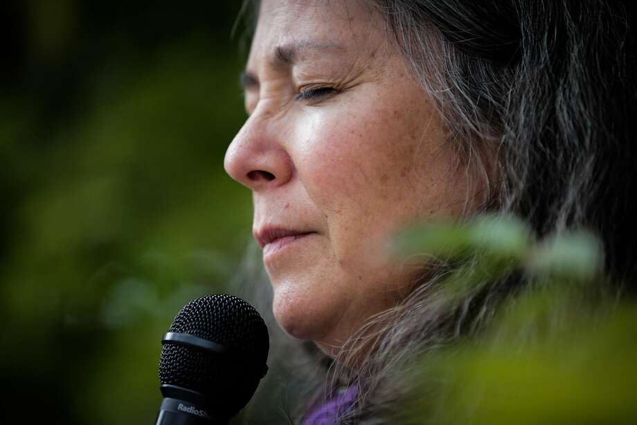 Reverend Leslie Takahashi leads the closing benediction during a prayer vigil held to honor those impacted by the housing crisis, ahead of the Concord City Council's Housing and Economic Development Committee meeting, in Concord, California, on Monday, Oct. 24, 2016. Photo: Gabrielle Lurie, The Chronicle