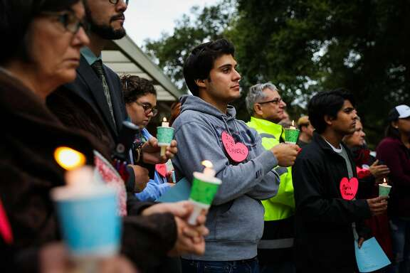 Pierre Prevot (center) holds a candle while listening to a prayer vigil, which was held to honor those impacted by the housing crisis, ahead of the Concord City Council's Housing and Economic Development Committee meeting, in Concord, California, on Monday, Oct. 24, 2016.