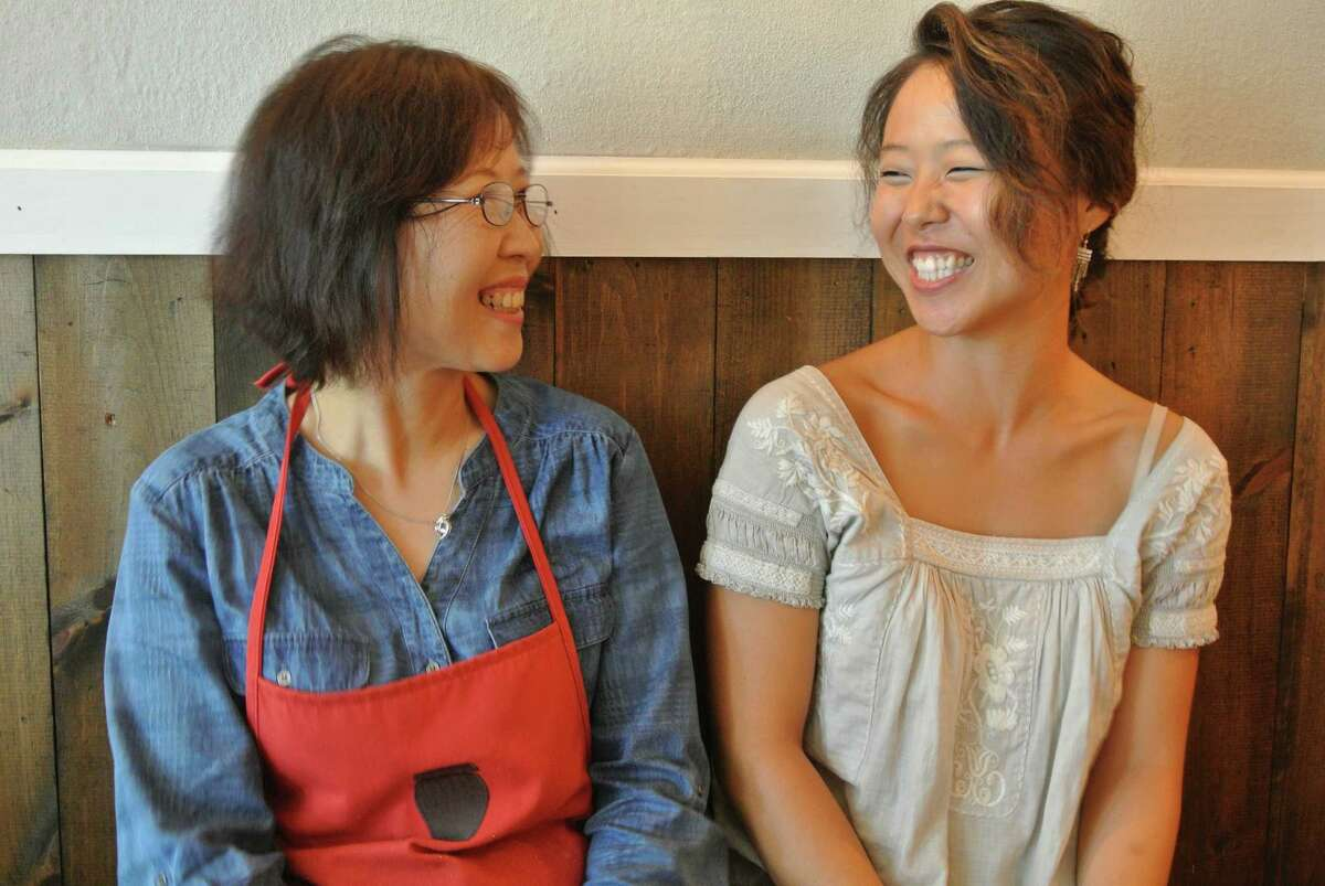 Chun Hee Kim, the chef at Sunhee's Farm and Kitchen, a Korean restaurant in Troy, and her daughter Jinah, who owns Sunhee's. (Deanna Fox)