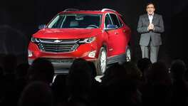 Alan Batey, GM president for North America and global Chevrolet brand chief, introduces the 2018 Chevrolet Equinox compact SUV last month in Chicago. Chief Financial Officer Chuck Stevens said Tuesday that GM will replace its compact and midsize crossover SUVs within the next 18 months.