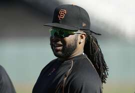 San Francisco Giants pitcher Johnny Cueto warms up before Game 3 of baseball's National League Division Series against the Chicago Cubs in San Francisco, Monday, Oct. 10, 2016. (AP Photo/Ben Margot)