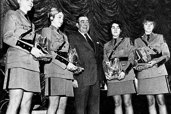 1974: The year the first four female state troopers graduated from the academy and began work. The first female New York State Troopers - Carol J. Johnston, Carol A. Desell, Maureen P. Gordinier and Regina M. Robbins - pose with Superintendent William E. Kirwan Jr. on Graduation Day, January 11, 1974. (Courtesy of the New York State Police Department)