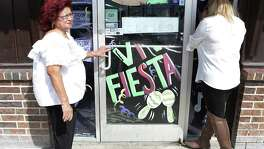 Gloria Ricondo, 73, left, and her granddaughter Ruby Contreras, both who worked as waitresses at the Malt House peer into the closed restaurant.