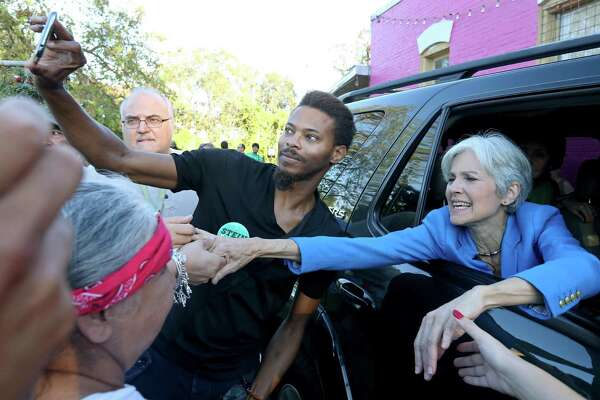 Green Party presidential candidate Jill Stein shakes hands with supporters as she leaves a campaign stop at Galeria E.V.A Sunday Oct. 16, 2016.
