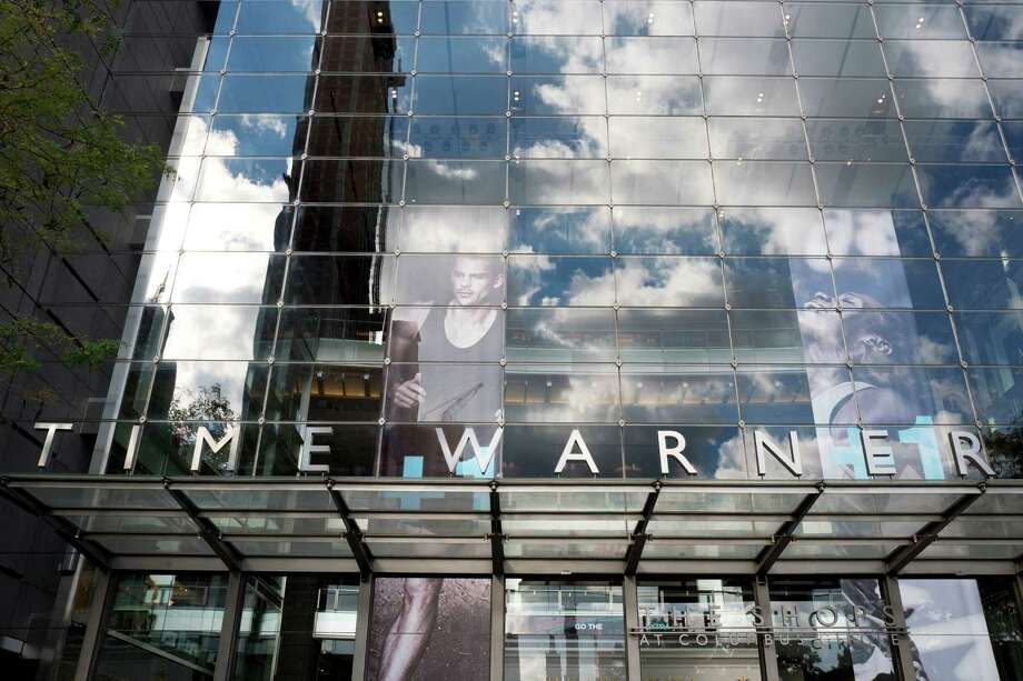Telecom giant AT&T wants to acquire media giant Time Warner to create a vertically integrated mega-corporation. Photo: Mark Lennihan, STF / Copyright 2016 The Associated Press. All rights reserved.