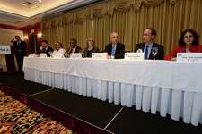 State REpresentative Fred Wilms (R-142), second from right, speaks as The Greater Norwalk Chamber of Commerce hosts a State Representatives Forum with Repsresentatives Gail Lavielle, Bruce V. Morris, Christopher R. Perone, Terrie E. Wood and candidates Randy Klein and Darline Perpignan. Tuesday, October 25,  at The Norwalk Inn & Conference Center in Norwalk, Conn.