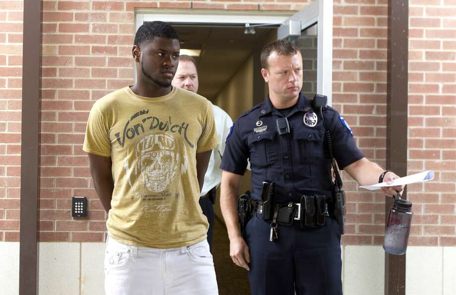 Santo Stephens is transferred from the Conroe Police Department to the Montgomery County Jail Tuesday, Oct. 25, 2016, in Conroe. Stephens is one of four men facing aggravated robbery charges following a deadly robbery at Jeff's Jewelry in Conroe on Oct. 3, 2016. Photo: Jason Fochtman/Houston Chronicle