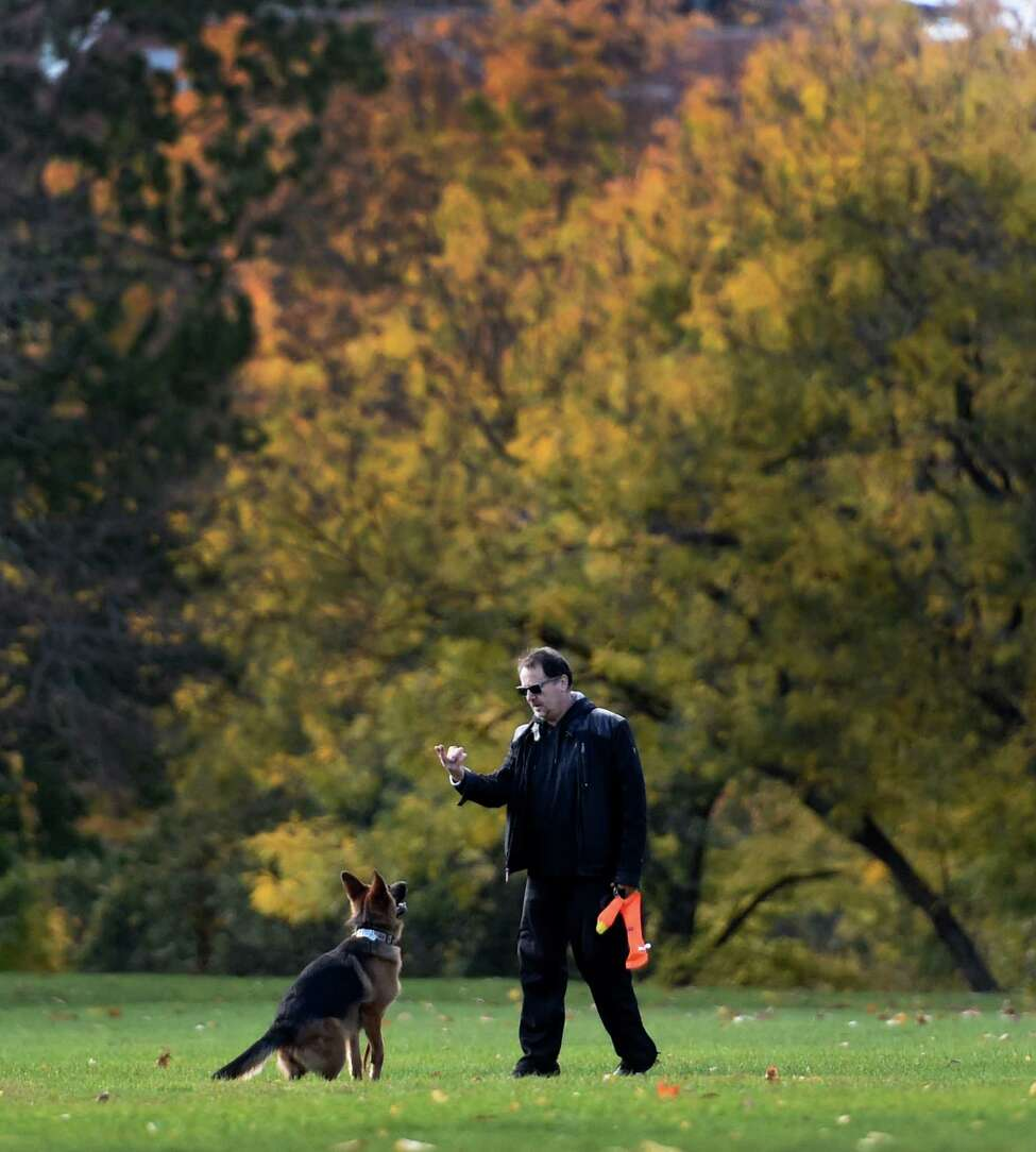 Oleg Jerusalemski does some puppy training with his dog, nine month old German Shepard